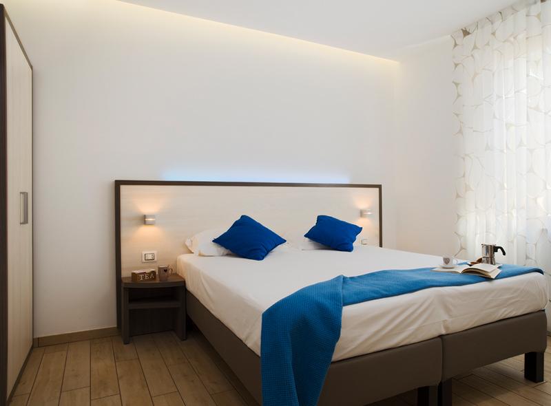 viverenumana-camera-matrimoniale-angolo-cottura-letto2