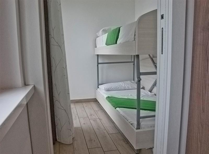 viverenumana-camera-quadrupla-letti